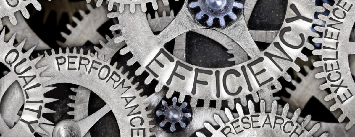 Gears with the words efficiency, quality, performance, and excellence on them.