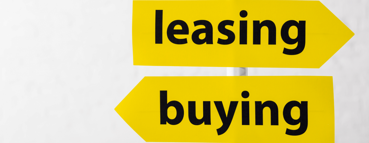 Yellow arrow signs pointing in opposite directions that say leasing and buying