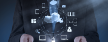 Business man holding iPad with holographic cloud computing diagram